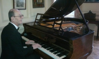 Brian on piano at Hedingham Castle